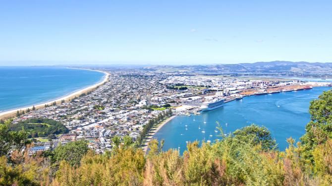 Tauranga, New Zealand. Panoramic view from Mount Maunganui of the white sand beach and City.