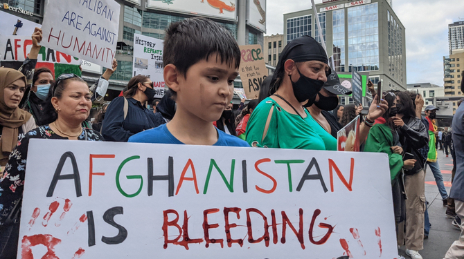 Toronto, Canada. August 15, 2021 Afghanistan protesters at Dundas Square in Toronto