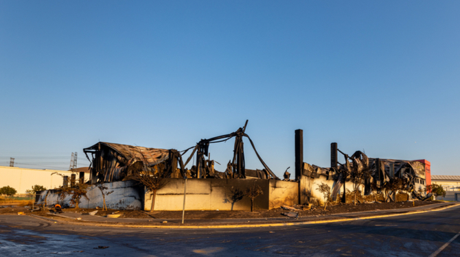 Durban, South Africa, 15 July 2021. A warehouse lies entirely burnt in the aftermath of violent protests that passed through the industrial area north of the city