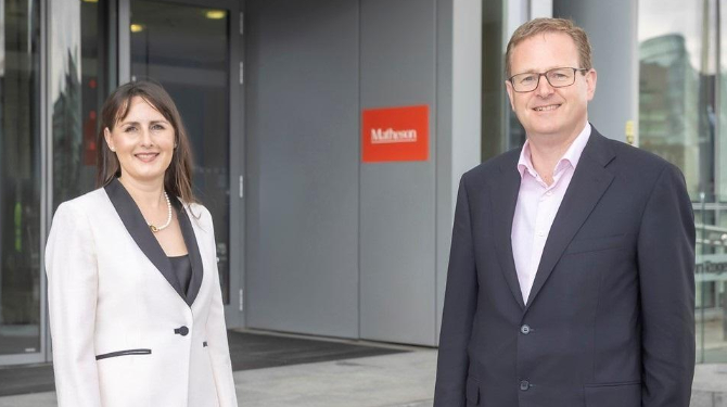Photograph of Niamh Counihan with Matheson managing partner Michael Jackson standing outside Matheson's offices