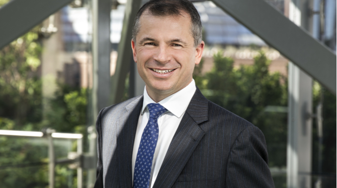 Photograph of Ashurst managing partner Paul Jenkins outside the firm's offices