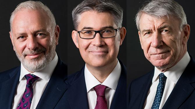 Portrait photographs of Michael Barnett, Mark Hastings and Mark Gill against dark background