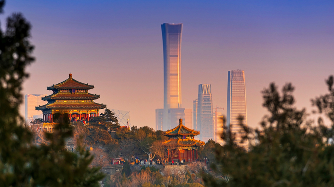 unset Beijing cityscape between ancient chinese architecture. historic buildings and Beijing modern building with sweet sun rise sky, Beijing, China