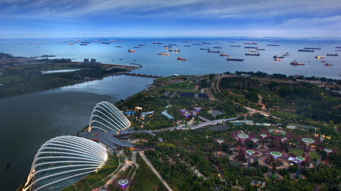 Cargo ships entering Singapore port