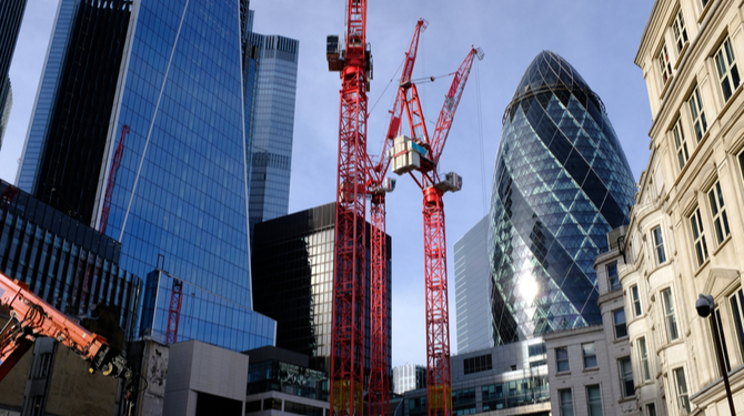 A view of the City of London from Fenchurch Street. The Gherkin, 52-54 Lime Street (The Scalpel) along with the construction of a new tower.