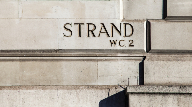 An Etched street sign for the Strand. A famous street in central London.