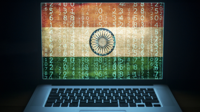 Laptop with binary computer code and India flag on the screen